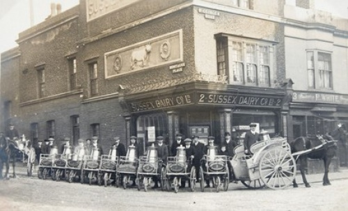 The milk delivery men about to go into action. Nine handcarts and two horse drawn floats ready to leave the Sussex Dairy Co. at 2 St George's Road, c1914.  Photo reproduced courtesy of James Gray Collection /The Regency Society.