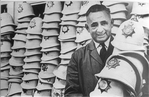 Brighton policemen's summer, white helmets with ex-policeman and storeman Bert Holcombe.  Photograph courtesy of Derek Oakensen and the Old Police Cells Museum/ Sussex Police Archives.