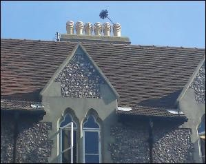 Picture courtesy of The Brighton Chimney Sweep. (Not for reproduction elsewhere.) Customers still like to see the brush coming out of the top of the chimney pot, it's meant to be lucky, as is shaking a sweep's hand, touching his shoulder and, the sweep's favourite, kissing his cheek.