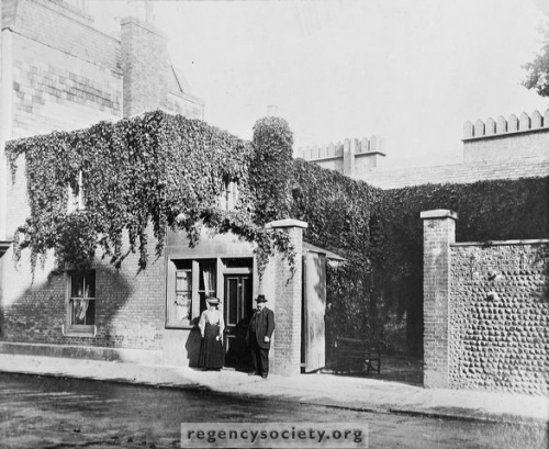 Photograph courtesy of the Regency Society.  The Dome Cottage, originally the coachman's cottage adjoining the Prince Regent's stables. Demolished in 1932.  Photograph shows Mr F W Brown and his wife.  He was works supervisor of the Pavilion Estate.