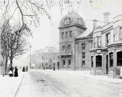 Preston Circus in the 1880s. Longhurst's Amber Ale Brewery, the Hare and Hounds Public House and in the background is the Stanford Arms Public House.